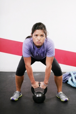 Woman Lifting Kettlebell