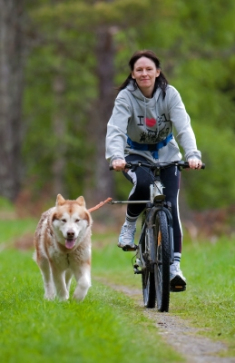 woman cycling with dog